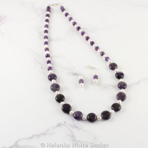 Amethyst necklace with freshwater pearls and matching earrings.