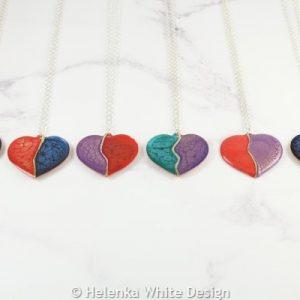 Painted copper heart pendants in various colours.