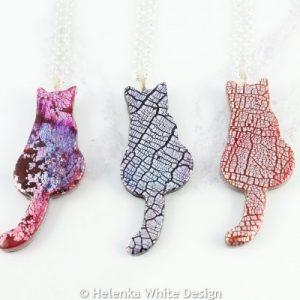 Faux dichroic sitting cat pendant in various colours.