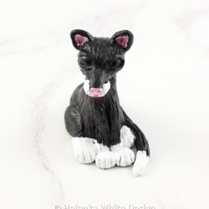 Black and white cat sculpture