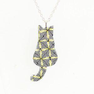 Yellow and black cat pendant.